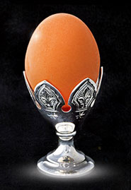 Серебряная подставка-пашотница для яйца.